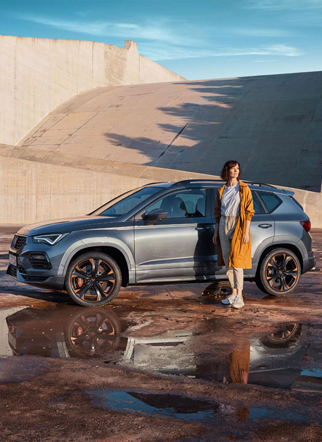 Woman standing next to a CUPRA Formentor 2020